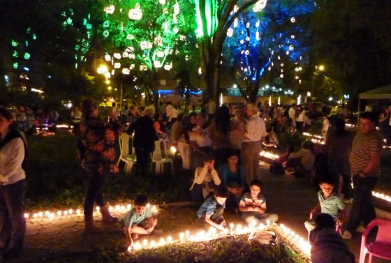 On Candle Night, parks and plazas are full of families lighting candles