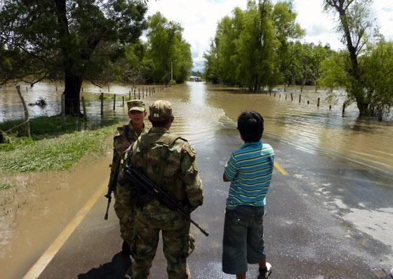 Flood waters block a road in Boyaca