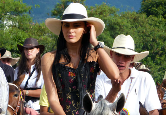 A young Paisa woman on horseback during the Cabalgata in Medellin