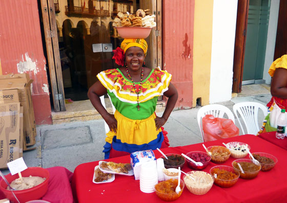 A traditional sweet seller in the Old City of Cartagena, Colombia