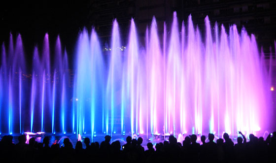 A water and light show on the banks of the Medellin River