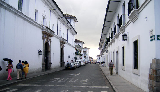 A Popayan street lined by whitewashed buildings