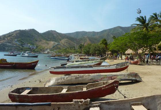 Taganga's beach lined with fishing boats