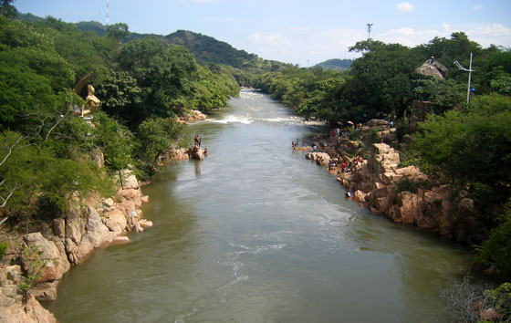 Hurtado River with the gold mermaid on the left riverbank, Valledupar